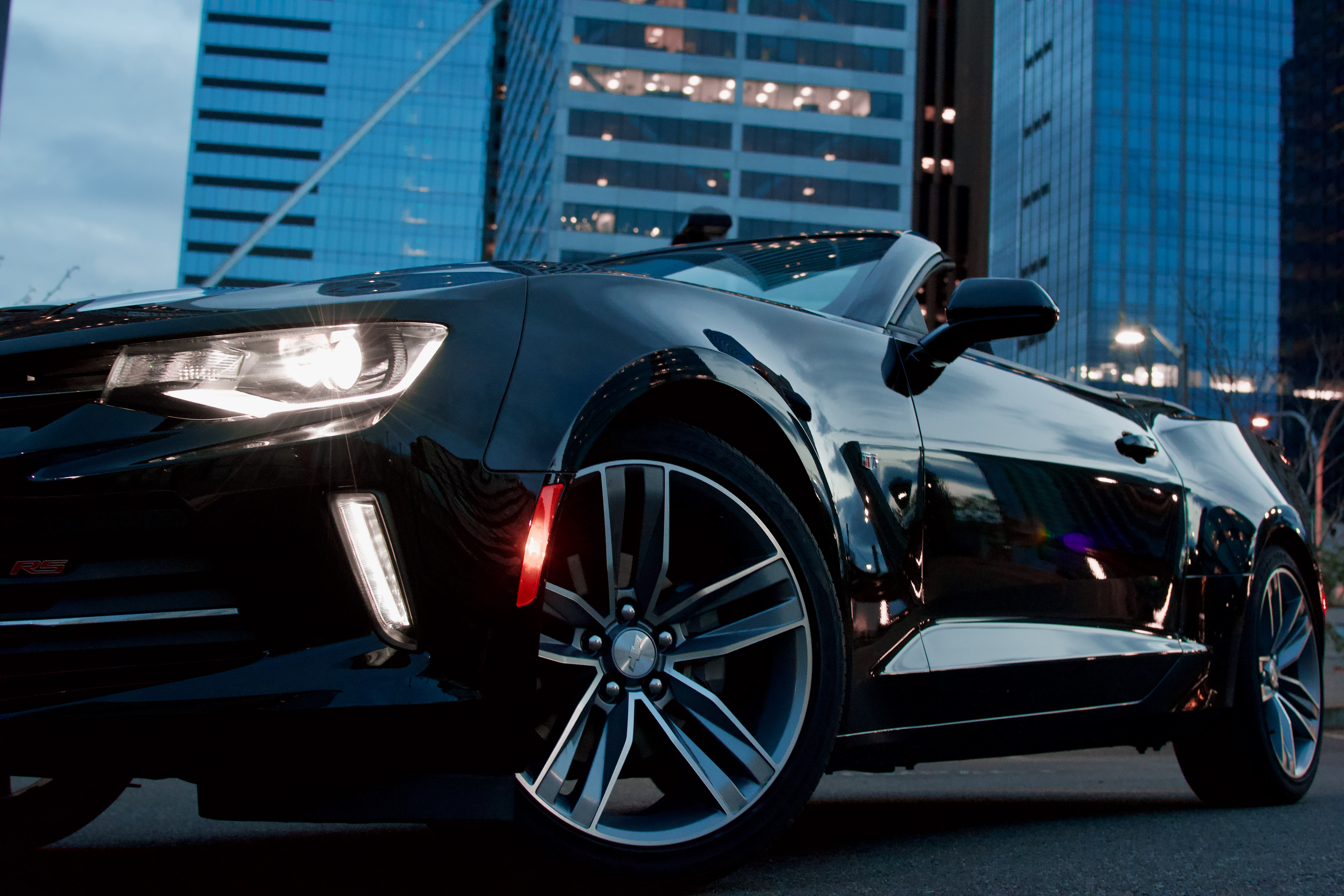 black convertible coupe parked near high-rise building