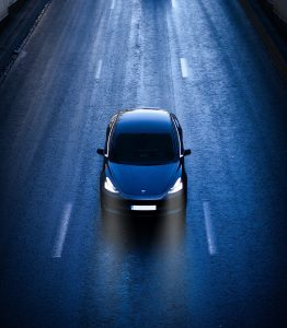 blue car on road during daytime