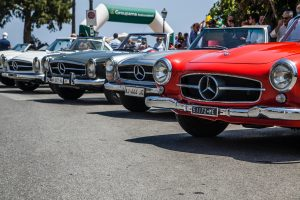 red and silver mercedes benz car