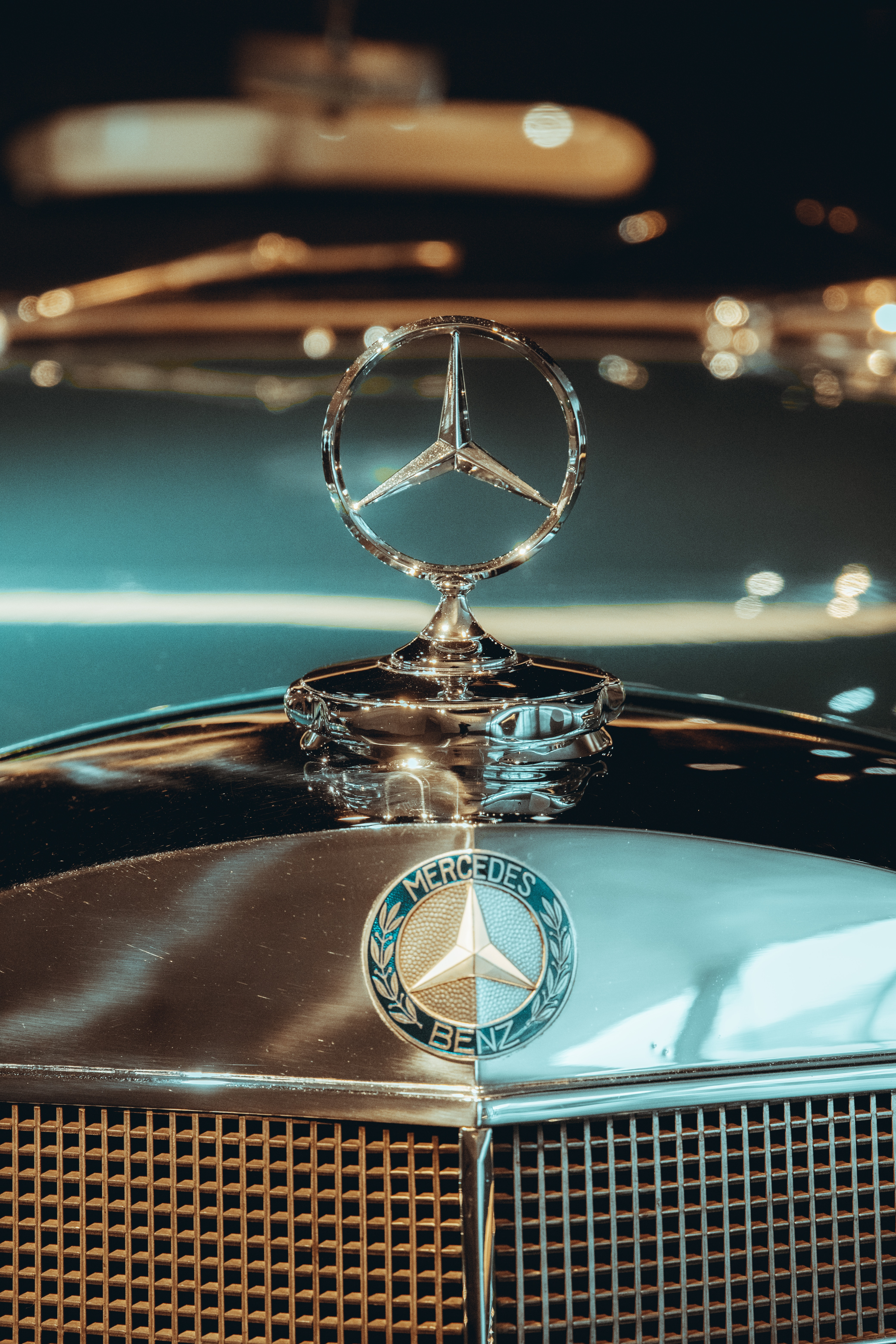 gold and silver car hood ornament